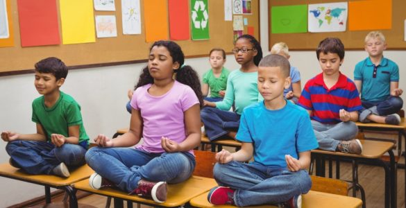 students meditation in classroom