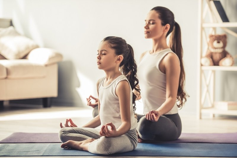 mother and daughter meditating